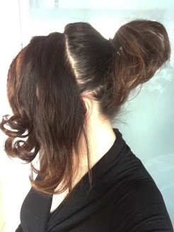 Create a deep side part from top of head to ear. Secure remaining hair in a ponytail.